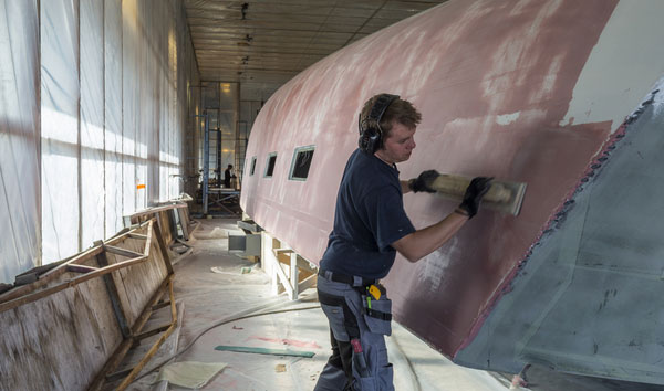 Skill, dedication and precision are key elements at Oy Nautor Ab. In a world ruled by machines, the human touch is still the most important ingredient for excellency. Working on the hull of Swan 115-001 at BTC in Pietarsaari, Finland.