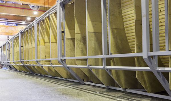 """Inside the """"lamination factory"""" at Kållby in Finland. The sheer scale of what goes on inside this plant is simply impressive. It's big, bold and beautiful, but it still holds the fascination and mystery of the older days of boatbuilding."""