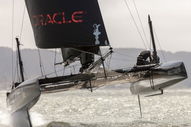 An ORACLE TEAM USA foiling AC45 during testing in 2013. Photo by Guilain Grenier