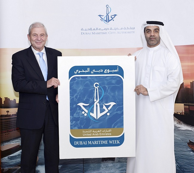 Amer Ali, Executive Director of DMCA, and Chris Hayman, Chairman of Seatrade Communications, with corporate identity of Dubai Maritime Week