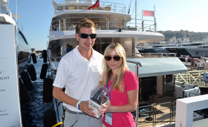 Michelle from Yachting Pages awarding a GoPro camera to Chris from Blush
