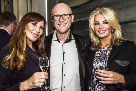 Alexis Lewis (L) pictured with close friends John and Claire Caudwell at the Mayfair Luxury Party, Davies Street, W1