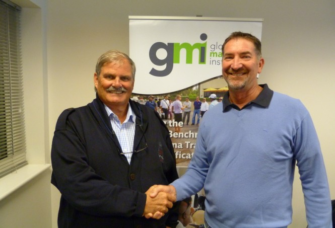 GMI Chairman Mick Bettesworth congratulating John Hogan on his appointment to the GMI