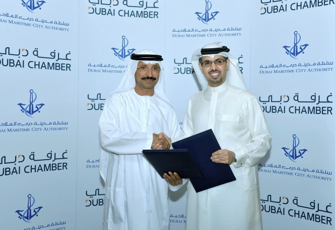 (Right to Left):  H.E. Hamad Buamim, President and CEO,  Dubai Chamber and H.E. Sultan Bin Sulayem, Chairman of Dubai Ports, Customs and Free Zone Corporation and President of DMCA, during the MoU signing ceremony.