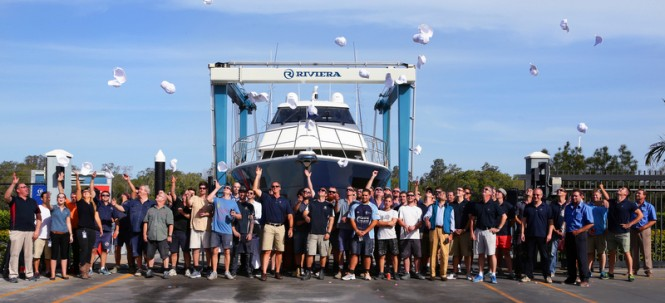 Rodney Longhurst and Riviera's team of master craftsman celebrate the launching of the new motor yacht 77 Enclosed Flybridge