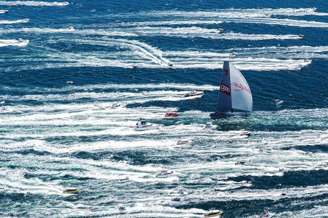 Wild Oats XI surges up the Derwent River towards Hobart amid a sea of white on her way to a historic eighth line honours victory in the Rolex Sydney Hobart Yacht Race. (Credit: Andrea Francolini/AUDI)