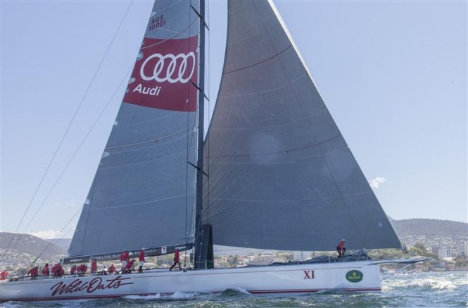WILD OATS XI (AUS) crossing the finish line to claim her eighth Line Honours victory in the 2014 Rolex Sydney Hobart Race - Photo by Rolex Daniel Forster
