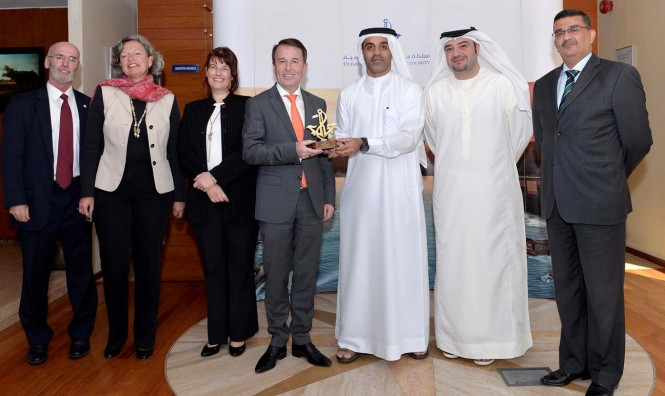 Amer Ali, Executive Director, DMCA, giving the Authority's shield to Prof Dr. Hans-Jorg Schmidt-Trenz, CEO, Hamburg Chamber of Commerce and the accompanying delegation at the headquarters of Dubai Maritime City Authority