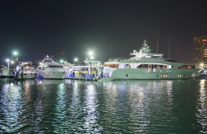 Night shot of the Gulf Craft fleet at the Kuwait Yacht Show 2015