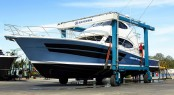 Riviera 77 Enclosed Flybridge Yacht Life Serenity in the travelift