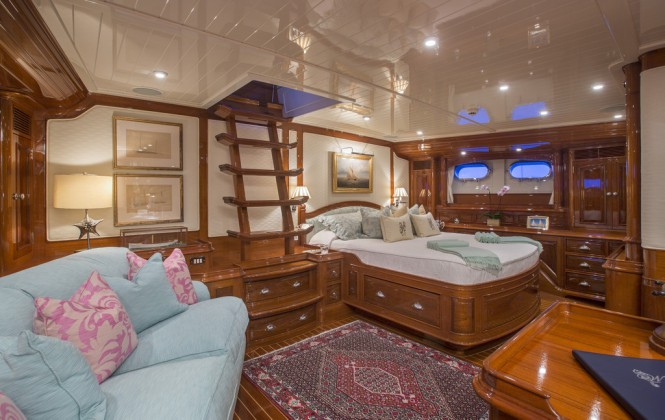 Whisper sleeps six guests comfortably in its three spacious staterooms. The master suite (left) includes an office area and a private companionway.  (Photo Courtesy of Whisper)