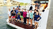 Group shot of the outreach program onboard the 72ft Mangusta Yacht DEFIANCE