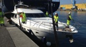 Princess 23M Yacht ISABEL being loaded on to a ship in Genoa, Italy
