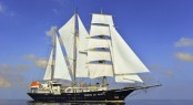 Sailing yacht RUNNING ON WAVES