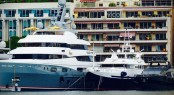 Three Luxury Superyachts wrapped by Wild Group moored in Monaco