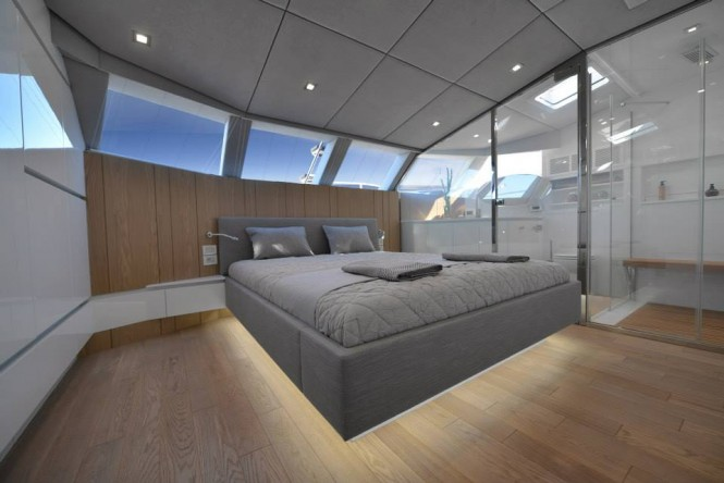 BLUE BELLY Yacht - Master Suite with an amazing glass panel separating his and hers bathrooms from sleeping area
