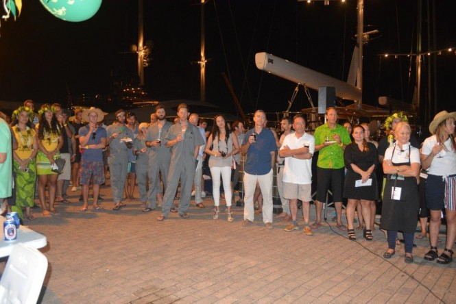 Crew from yachts cruising the region gather in Marina Taina to hear the announcement