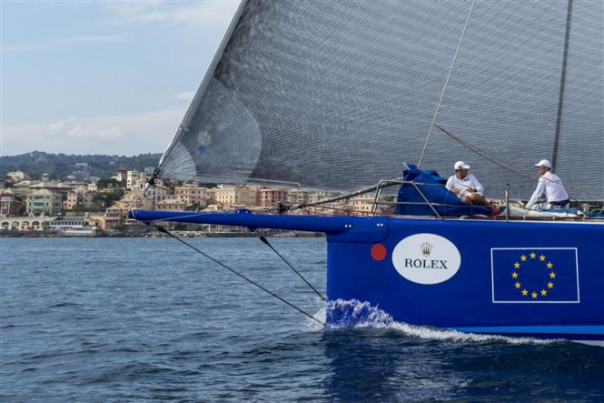 ESIMIT EUROPA 2 Yacht approaching the finish line in Genoa - Photo by Rolex Carlo Borlenghi