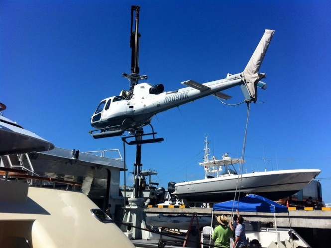 Benoa Harbor Bali - plane loading on superyacht