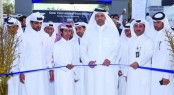 HE the Minister of Economy and Commerce Sheikh Ahmed bin Jassim bin Mohamed al-Thani cutting a red ribbon to formally open QIBS 2015