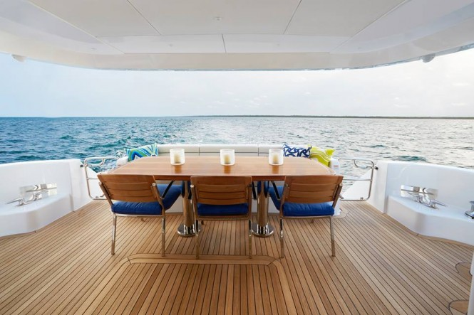 Hatteras 70 - Large aft deck dining area