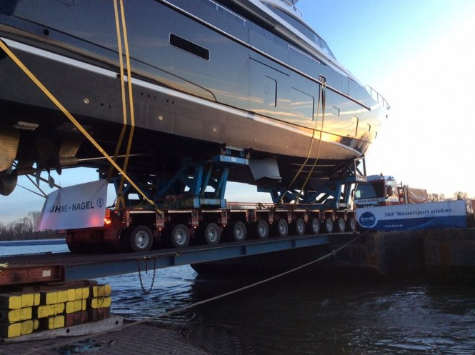 Princess 30M KOHUBA makes her way from the barge onto the road to the exhibition centre - Image by Princess Yachts International plc