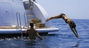 A superyacht charter diving in from the aft deck
