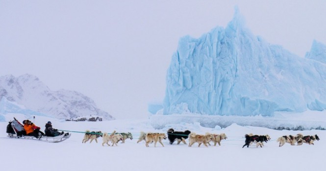 Dog sledding is still used as transport across Greenland toady.
