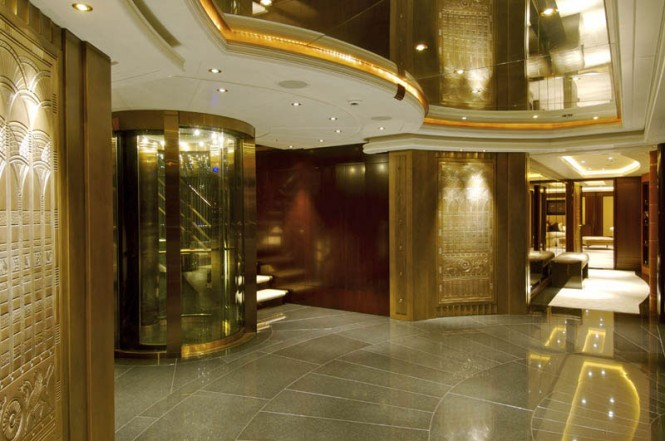 Luxury yacht KISMET - Lift with detailed golden decoration panels