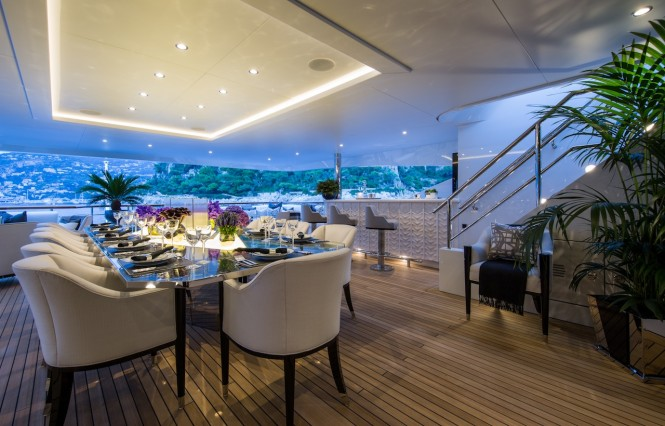 Luxury yacht 11.11 - Aft upper deck alfresco dining and wet bar. Photo credit Jeff Brown
