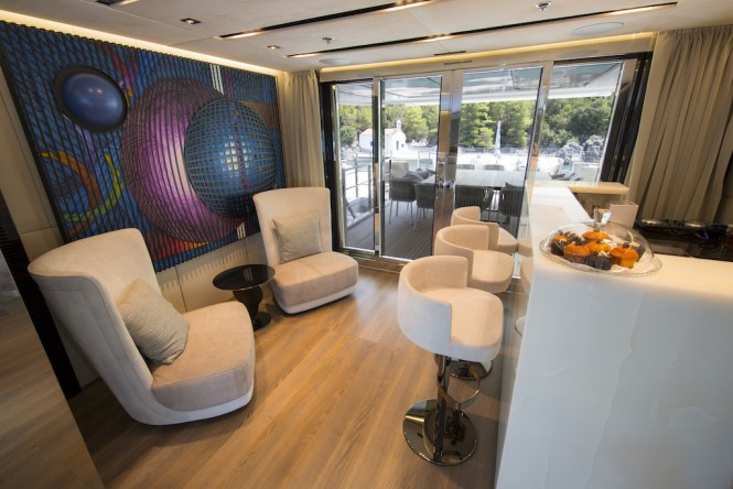 The skylounge wet bar and upper aft deck dining