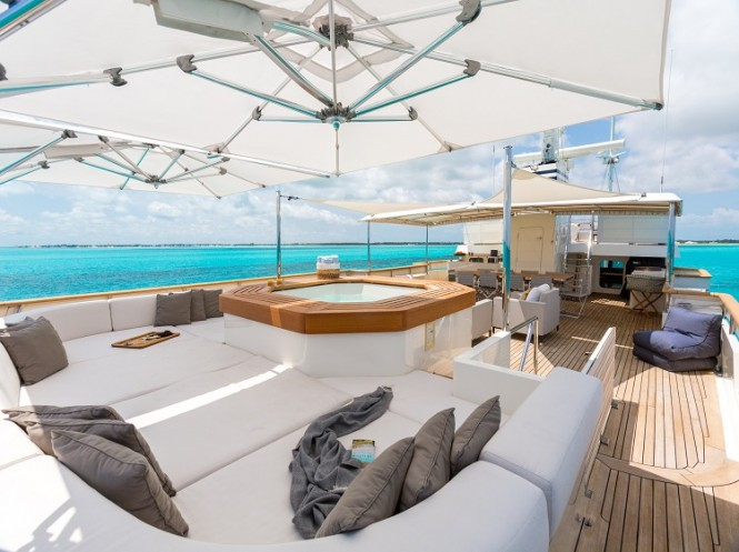 The lower sundeck Jacuzzi and sunpads on expedition yacht PIONEER