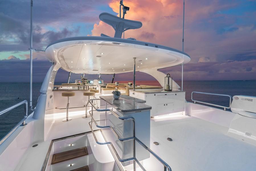 The Horizon Yacht E98 - Do It Now - flybridge in evening