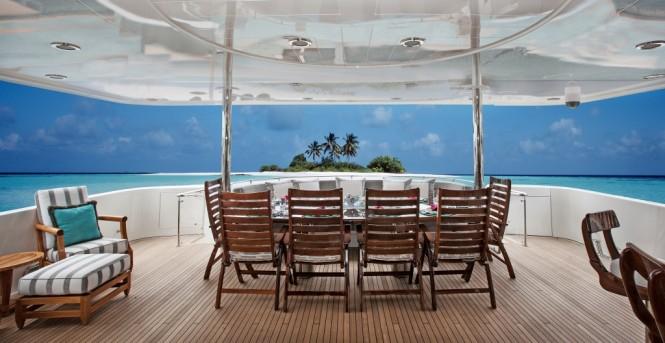 Aft deck alfresco dining aboard superyacht KEMOSABE