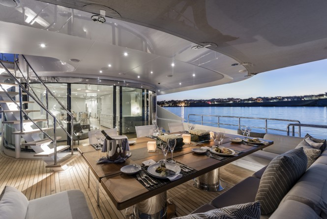 Alfresco dining on the main deck aft of superyacht DESTINY
