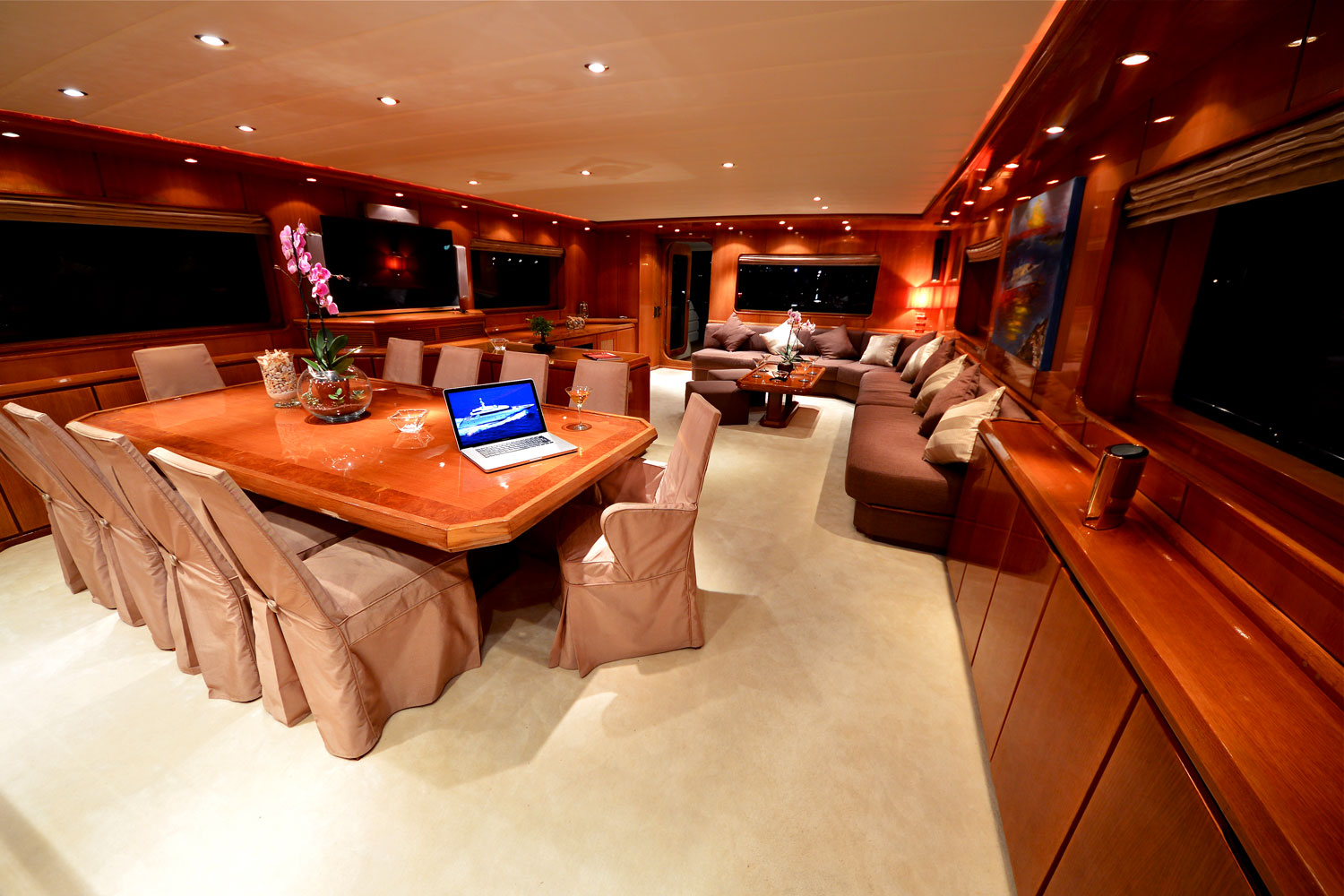 Formal dining area and maon salon aboard superyacht for Formal dining area