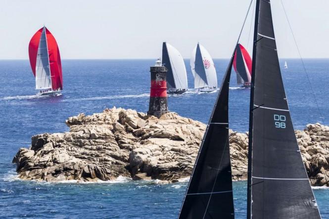 The rocky coast of Sardinia creates an impressive setting for the Loro Piana Superyacht Regatta. Photo credit: YCCS