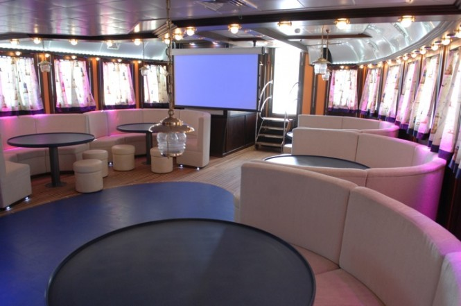 The main salon with cinema system aboard luxury yacht RUNNING ON WAVES