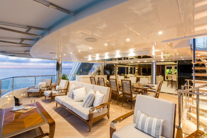Upper aft deck alfresco dining aboard superyacht KING BABY