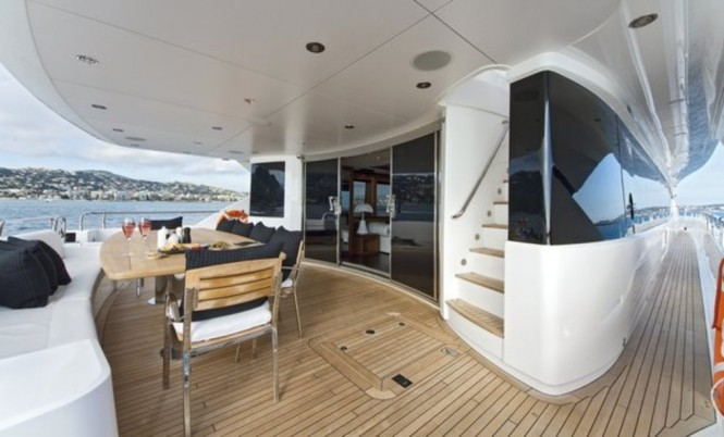 Alfresco dining on the aft deck of luxury yacht BLACK AND WHITE