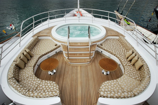 Inviting sun deck with a Jacuzzi to watch amazing horizons from aboard MINE GAMES