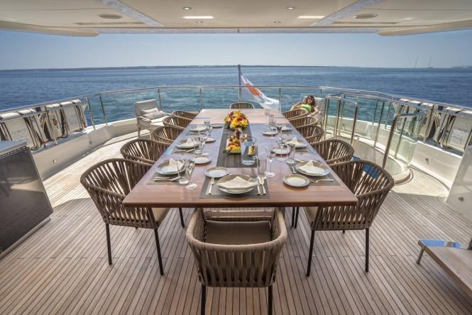 Upper deck aft alfresco dining aboard M/Y ANKA