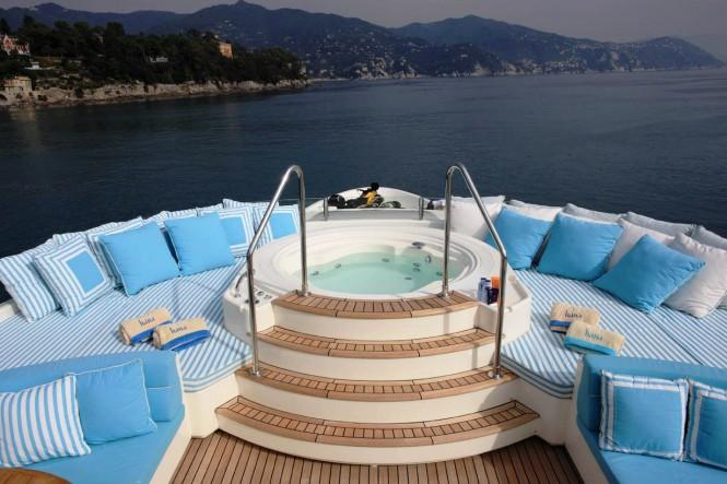 Jacuzzi and sunpads on the sundeck of luxury yacht HANA