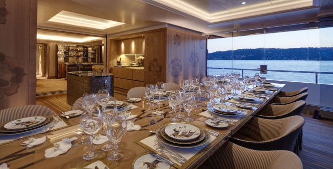 Motor yacht JOY - Exceptional woodwork surrounding the formal dining room. Image credit Feadship