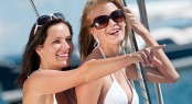 Two Attractive Smiling Woman On Sailboat