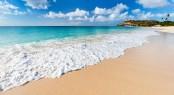 Idyllic tropical beach on Barbuda island in Caribbean with white