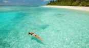 Woman swim and relax in the sea. Happy island lifestyle. White s