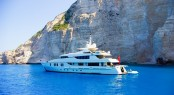 Luxury White Yacht Navigates Into Beautiful Blue Water Near Zaky