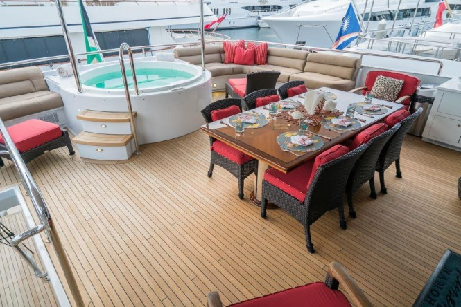 Luxury yacht NICOLE EVELYN - Upper deck dining and Jacuzzi