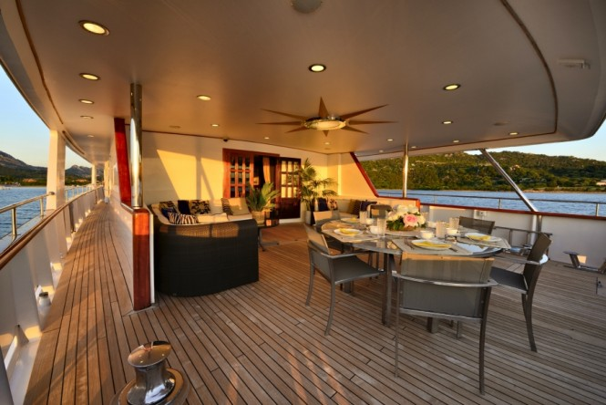Main deck aft dining aboard motor yacht COMMITMENT